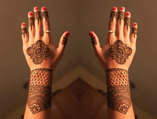 young-girls-back-hands-and-arm-henna-designs