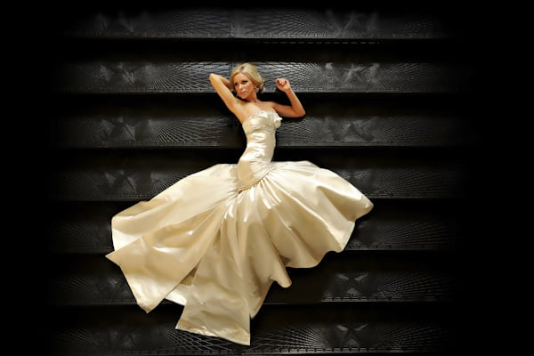Bride Laying on Black Staircase - Fine Art Wedding Picture