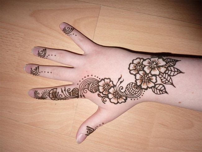 Henna Tattoo Flower Designs on Back Hand