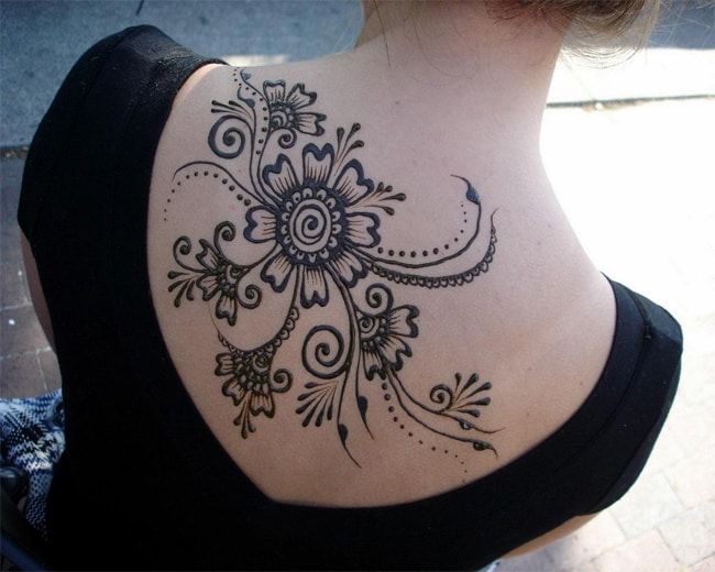 Women Henna Flower Designs on Upper Back