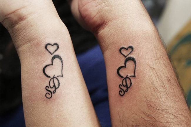 30 cute relationship tattoos designs pictures sheideas for Tattoo party ideas