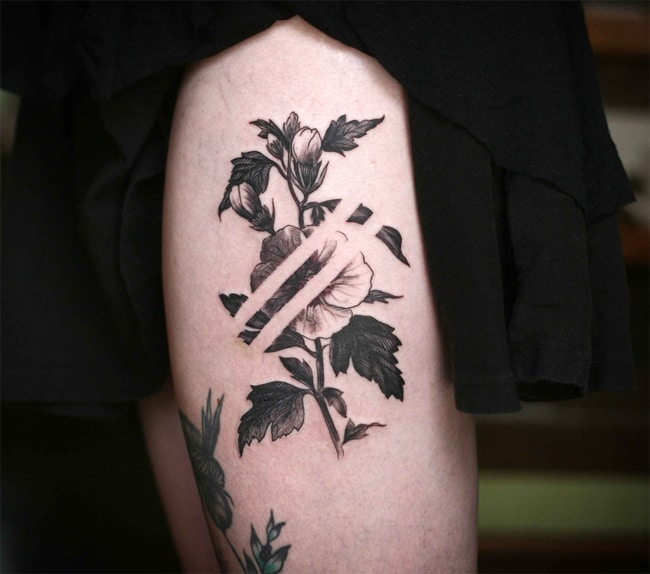 Amazing Negative Space Thigh Tattoo Ideas
