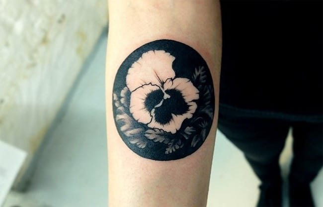 Negative Space Hibiscus Arm Tattoo Designs