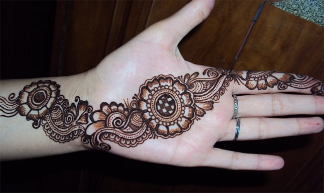 Elegant Peacock and Round Tikki Mehndi Designs