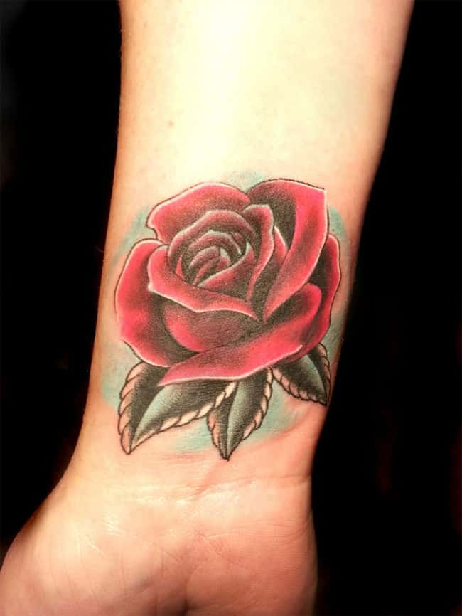 latest-rose-cover-up-tattoo-on-wrist-for-girls