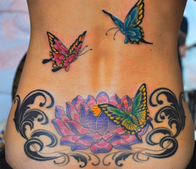 lower-back-cover-up-flying-butterfly-and-lotus-flower-tattoos