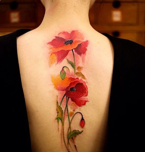 superb-female-flower-tattoo-design-on-back