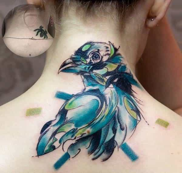 watercolor-bird-upper-back-cover-up-tattoo-for-women