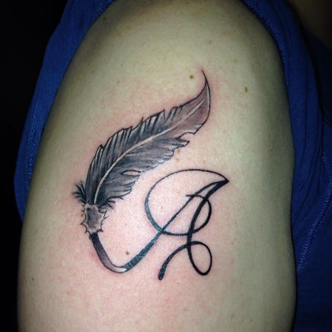 A Letter And Peacock Feather Armband Tattoos Sheideas