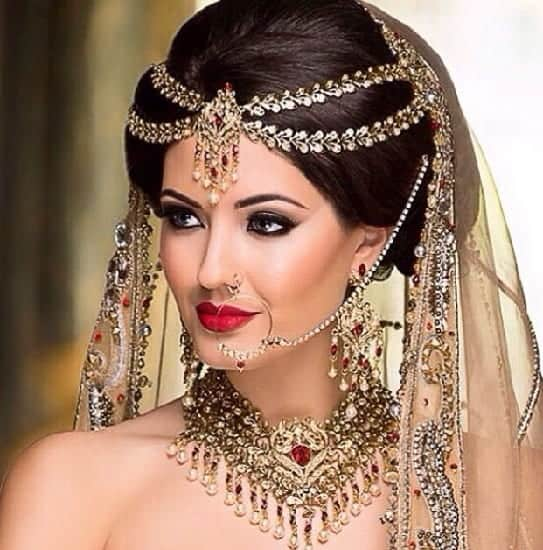 indian bridal hairstyle with high bouffant bun