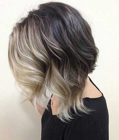 inverted bob with highlights haircut short in back long in front