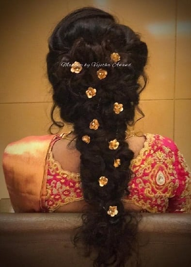Bouffant messy braid hairstyle with lehenga