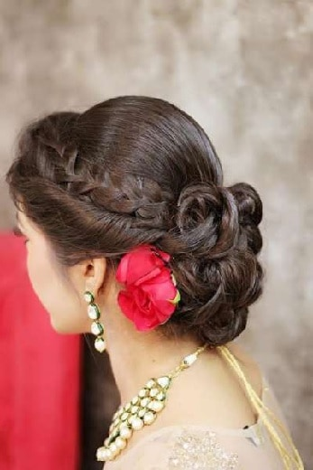 side braided hairstyle with low bun for lehenga