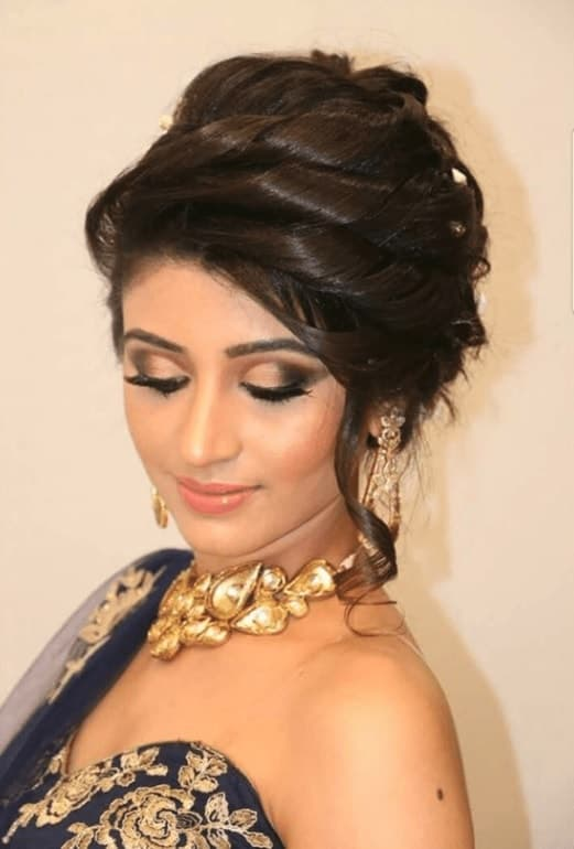 curled updo with indian gown