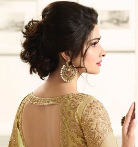 indian bridal hairstyle with puffed updo