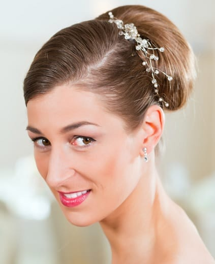 Sleek side parted backcomb hairstyle for indian bride