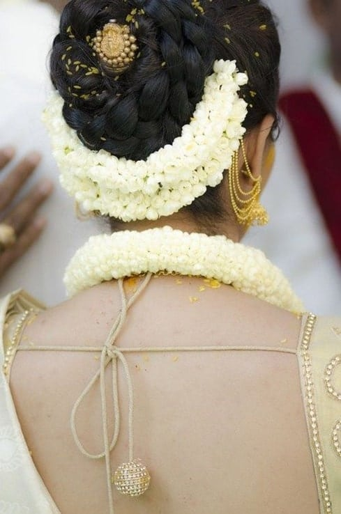 indian bridal hairstyles with braided bun