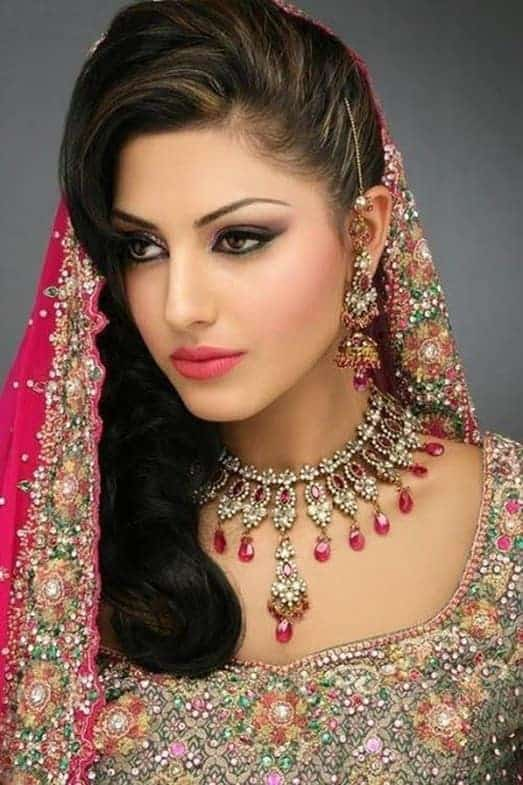 indian bridal hairstyle with side swoop curls