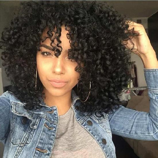 Kinky curly sew-in bangs hairstyle
