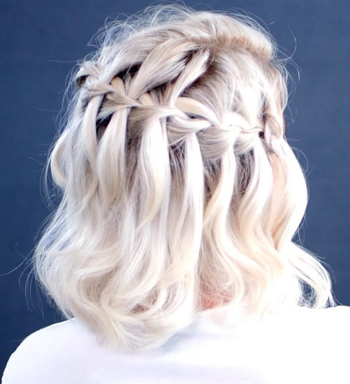 simple waterfall braid hairstyle for mother of bride