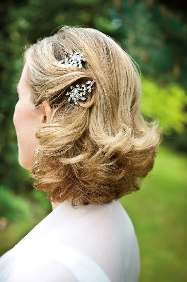 pinned curls hairstyle for brides mother