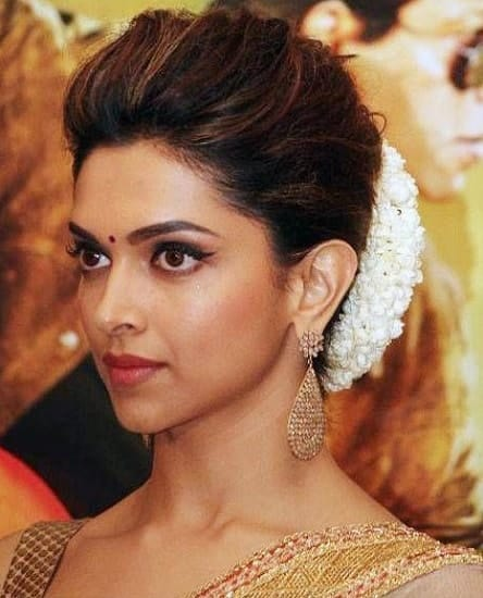 low bun hairstyle for south indian wedding