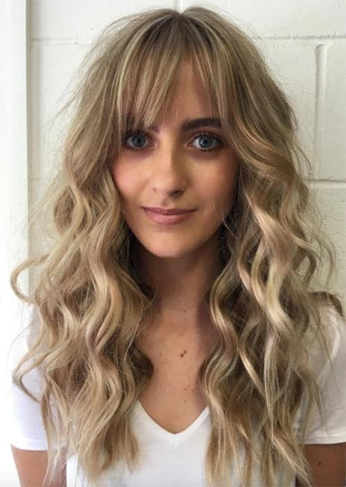 blonde curls with bangs