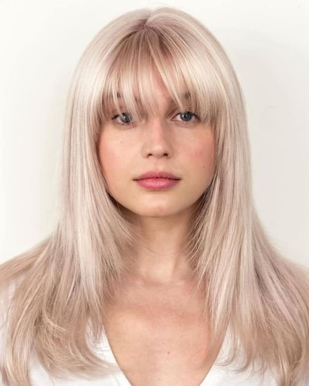 platinum blonde hair with long bangs