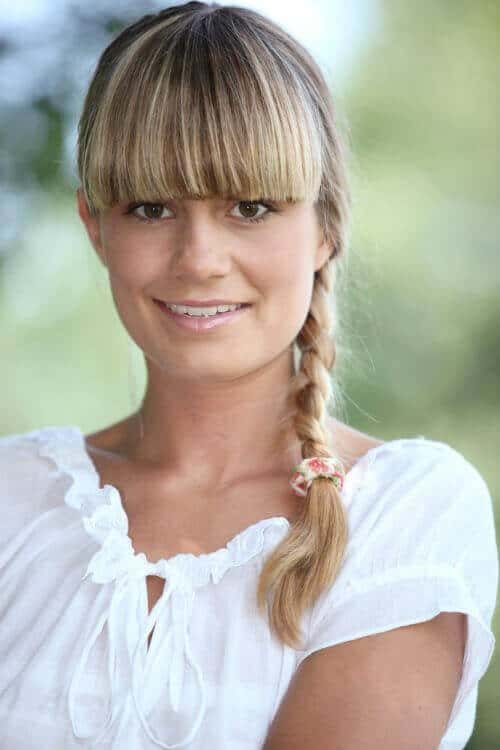 blonde braid with thick bangs