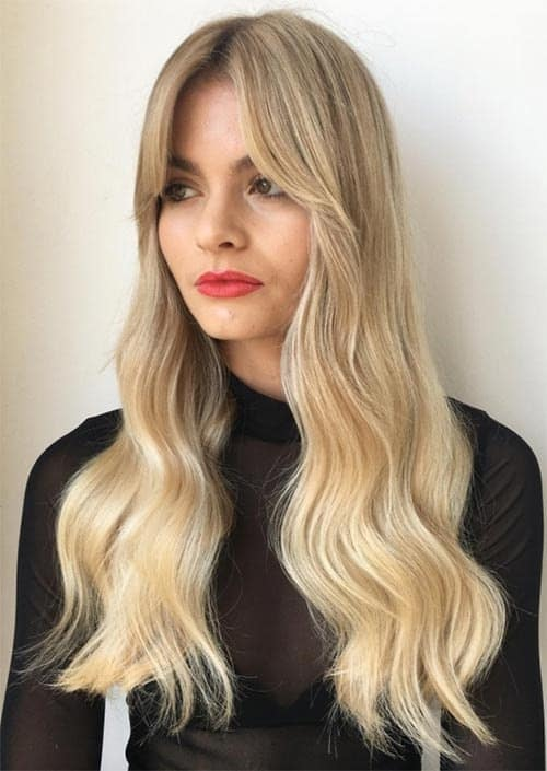 long blonde wavy hair with bangs