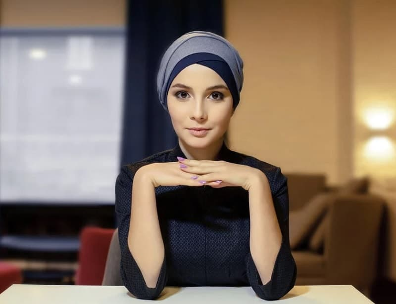 wrapped scarf on head of women