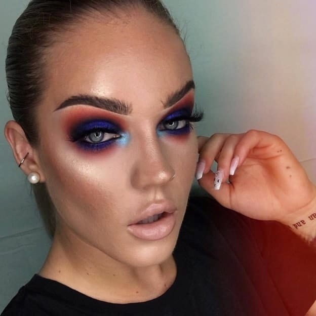 dark tone makeup with blue eyes
