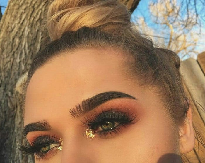 Black eye makeup with Golden Inner Eye Glitter