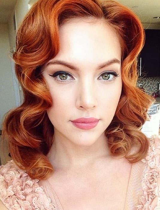 redhead with winged eye makeup