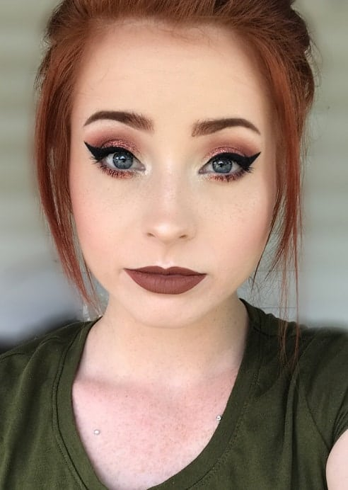 redhead with winged eyes