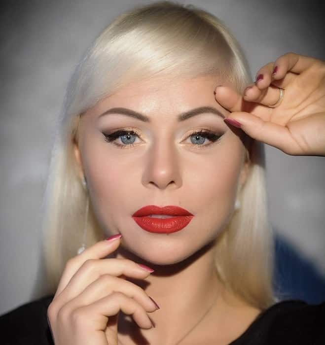 blonde girl with bold red lips